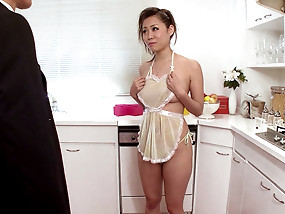Japanese maid in skimpy cooking apron gets her slutty mouth filled with hard dick.